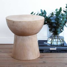 """""""Champagne cork"""" stool made from solid jacaranda wood."""
