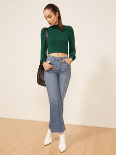 Throw on and go. This is a slightly cropped top with a mock neck and slightly puffed shoulders and cuffs.