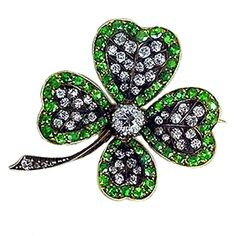 An English gold, silver, diamond and demantoid brooch in the form of a lucky four-leaf clover, c.1880. (jewelry.1stdibs.com)