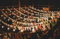 Yellow and white bunting connecting columns with lights...