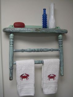Back legs of a chair for towel rack, seat as a shelf.