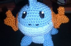 Mudkip  Materials used  worsted weight yarn in light blue, medium blue and gold  black felt  H hook  fiber fill  needle and thread
