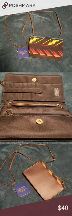 """Pendleton Crossbody Brand new with tags! Small,  slim wallet with several pockets. It is a crossbody with several pockets including one on the back. 7.5"""" long 5"""" high. Featuring Pendleton wool and genuine leather. The pattern is called arrow path. Pendleton  Bags Mini Bags"""