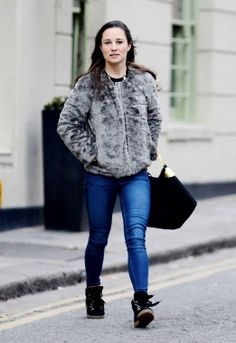 Skinny jeans with ugly flat boots make your legs look short. The coat does not help, either.  Pippa on 1/25/2013