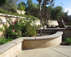This #patio project has poured in place fields of fawn color and coffee colored borders and wall caps. The #concrete was designed with an exposed sand finish, sometimes described as a washed finish.