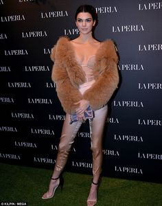 Model on the move: Kendall Jenner put on another typically stylish display while attending the La Perla showroom opening in the heart of the Milan's upscale shopping street, Via Monte Napoleone