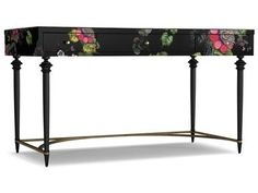 Desktop artfully covered in the designer's signature floral with curved drawer fronts. Set on a fluted-leg base with metal stretcher for ample legroom.