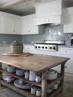 reclaimed wood island, LOVE the top, but I think I'd have to have an actual cabinet with doors underneath... of reclaimed wood too! :)