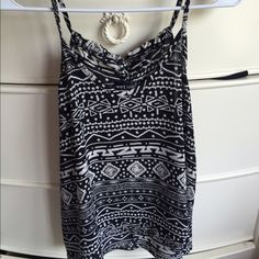 Tribal tank top Tribal tank top. The straps tie together in the back Wet Seal Tops Tank Tops