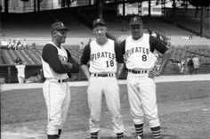 """This photo by Charles """"Teenie"""" Harris shows three Pittsburgh Pirates baseball players, Roberto Clemente, Billy Virdon and Willie Stargell, standing on Forbes Field, c. 1965."""