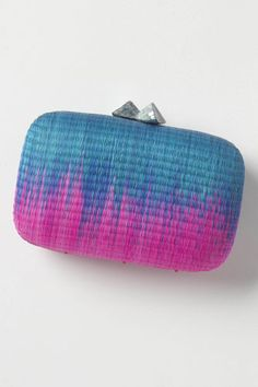 Serpui Marie Bruna Ombre Clutch - ombre is everywhere, and this cute little clutch reflects the trend perfectly. Bright and tropical without being obnoxious, this cute rounded box-style clutch is topped off with an unexpected clasp. The structured shape nicely contrasts the organic blend of hues and natural textures. #r29summerstyle