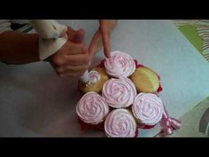 2 painfully detailed videos on how to make a cupcake bouquet.  Great!
