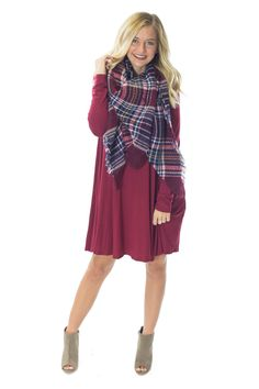You simply must have at least one of these long sleeve tshirt dresses in your closet for fall. They are easy to dress up, down, and wear anywhere. You can pair them with leggings as it gets chilly also. These dresses feature pockets and fit true to size. Our model is wearing a small.