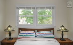 We installed these two double hung windows in this lovely bedroom in Westbury...  Home Improvements / Home Renovations / Home Remodeling / New replacement windows over the bed from Renewal by Andersen Long Island