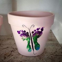 Footprint Butterfly! Great Mother's Day idea from https://www.facebook.com/Art4Soul    Bring your baby in to Art 4 Soul and get started on your Mother's Day gifts! What grandma, mom or aunt wouldn't want this?!