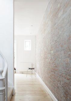 Brick wall. Copenhagen Townhouse I by Norm.Architects. Photo by Jonas Bjerre-Poulsen.