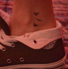 Bird ankle tattoo. Dont know if I lov the tat or the shoes :)