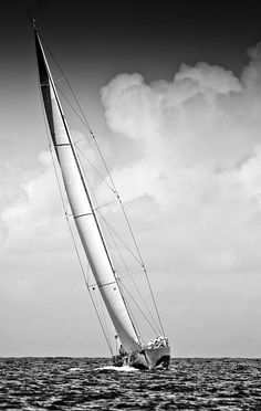 Lovely composition. I can really feel the wind blowing by the placement of the clouds in relation to the sail.