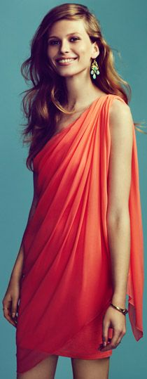 Tangy orange drape dress: Drape dress that drape down from the shoulders cascading down to the knee length level. Drape arranges the cloth or let fall in loose folds.     (vivien tan, FMM1B2)