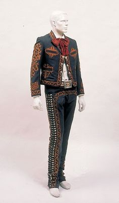 A charro suit from the was manufactured by Casa Encinias of suede, silver and cotton with a silk tie. (Courtesy of Alejandra Fernandez Capistran) Mexican Costume, Mexican Outfit, Mexican Dresses, Mariachi Suit, Charro Outfit, Charro Wedding, Western Costumes, Mexican Men, Western Suits