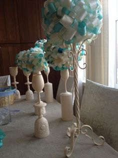 I dont like the poofy ribbon thing but the double ended wine glasses painted white is a great idea.