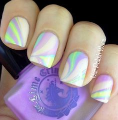 The trick for Marbling your nails is to put petroleum jelly around your nails, on all fingers. Take a cold cup of water, drop your 2 colors in, then gentally lay your finger on top.   :)