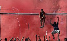 Independiente's fans cheer their team during an Argentine league soccer match against Racing Club in Buenos Aires, Argentina, Saturday April 14, 2012. Independiente won 4-1. (AP Photo/Natacha Pisarenko)