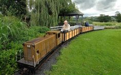 Garden Railroad Group Of Garden Railway Hobbyists Grows In Popularity In The Twin Railroad In My . Live Steam Locomotive, Ride On Train, Eight Passengers, Garden Railroad, Milwaukee Road, Hobby Trains, Ride On Toys, Model Train Layouts, Back Gardens