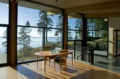 Not a chance that I 'd get rid of the trees!  A cabin on Whidbey Island, Washington that was designed by CHESMORE|BUCK Architecture.