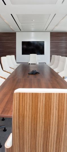Boardroom design idea. Wood finish and cream leather seats in Rethink's corporate boardroom. The office was designed and fit-out by Interaction.