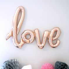 Giant Love Script Balloon. A single 102cm balloon in rose gold, scripting the word 'Love'  This gorgeous and unique balloon is the perfect accessory for your Engagement, Wedding or Hen Party.