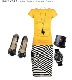 Love the yellow shirt and black striped skirt!