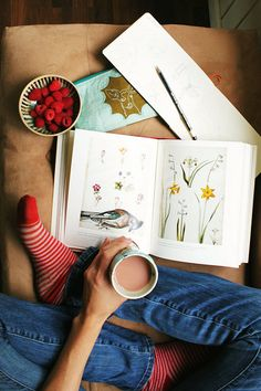 Look at this. This is just perfect. And adorable. The socks, the coffee, the art, and the raspberries! Cuteness.