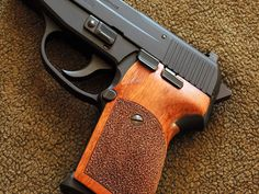 Sig-Sauer P239 chambered in .357 Sig wearing Nill stippled wood combat grips (part number SS075)