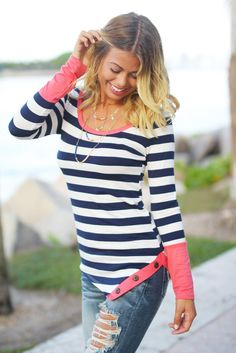 IT'S BACK!!! Our Navy And Coral Striped Top With Buttons is such a comfortable, casual, and amazing piece! We love this top when combined with jeans, leggings or shorts - it is the perfect shirt that