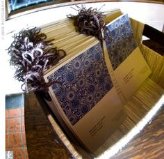 In keeping with the eco-friendly theme, the ceremony programs were printed on recycled paper and tied with hemp yarn. They were printed with a typewriter font, and the cover featured a beautiful origami paper print of stylized deep blue chrysanthemums.
