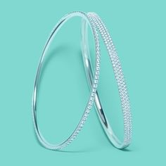 Tiffany Metro diamond bangles in 18k white gold. #TiffanyPinterest