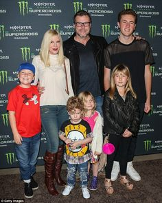 Big family: The former Beverly Hills 90210 star has four children with Dean, 49. The Canadian also has a son Jack, 17, from his first marriage. They're pictured at a Supercross event in Anaheim, California, in January