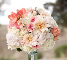 LOVE THIS BOUQUET. @Chelsea Bennett @Danae Reyes click on this and check out the website. I like the aqua as well.
