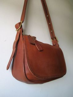 Your place to buy and sell all things handmade Saddle Bags, Coach Handbags, Coach Bags, Leather Crossbody, Crossbody Bag, Bonnie Cashin, Vintage Coach, Brass Hardware