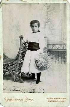 Young African American girl standing in a white dress with a black sash and holding a large hat. Want to know more about Black History ? American Women, American Photo, American Art, American Fashion, Afro, African American Culture, Vintage Black Glamour, Black Image, African Diaspora