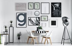 Different size picture frames on wall
