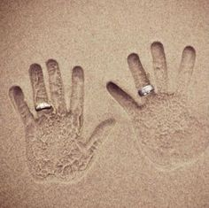 Bride & Groom hand prints with wedding rings in the sand. Adding the wedding date in the sand would be a cute idea too!