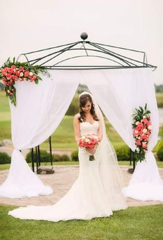 Outdoor wedding at Metamora Fields in Metamora, IL.  Soft and romantic fabric draping backdrop with tropical floral tiebacks.  Perfect for a spring or summer wedding.