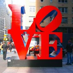 Robert Indiana's Love Sculpture on Sixth Avenue and 55th  Street in NYC is almost as iconic as the   Statue of Liberty.