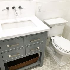 A fun job site pic of kids' bath! I love the super high backsplash. I selected wall-mount faucets because we needed every inch of countertop space! Obsessed with the cement tile! #beachhouse #cottage #cementtiles #KDdesigns #Newport Beach