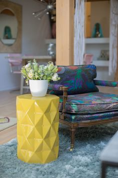 OMG We're Coming Over: Shameless Maya's Loft Makeover | Details: Vintage lounge chair and a yellow side table!