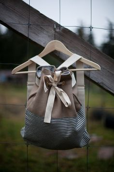 Canvas Drawstring Backpack- bad link but I like the contrasting fabrics and style of this backpack