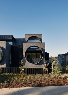 World Architecture Community News - Oversized circular windows dominate the facade of Cirqua Apartments in Melbourne Modern Residential Architecture, Facade Architecture, Amazing Architecture, Roof Design, Facade Design, Window Design, Melbourne Apartment, Brick Facade, Modern Buildings