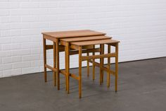 This is a set of three vintage Mid-Century solid oak side tables by Hans  Wegner. Each one slides under the other.  $900  MIDCENTURY MODERN FINDS